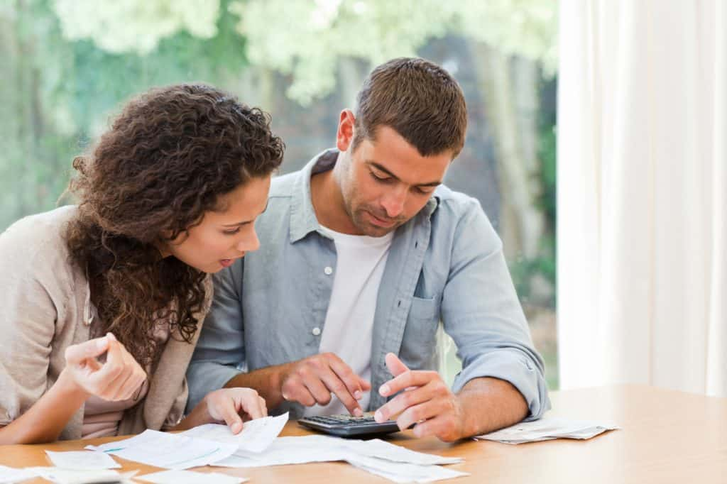 couple discussing budgeting mistakes